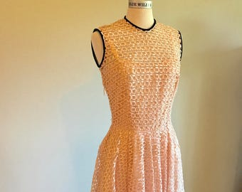 Vintage 1950's pinup new look pink ribbon woven lace dress with black velvet trim Size Small