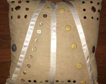 Pillow of sentimental buttons
