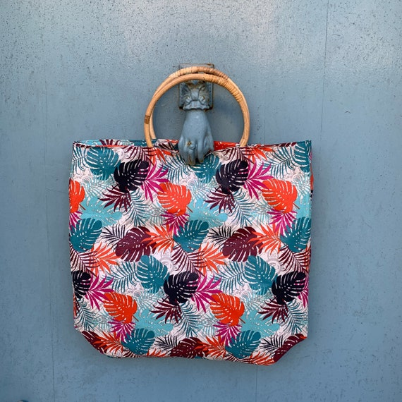 Tote or totebag coated cotton with colorful foliage bamboo handles.