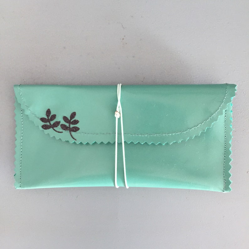 Small light green leather pouch