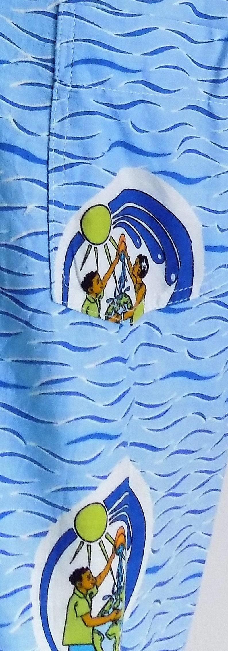 Mans blue patterned shirt eau vive un monde meilleur living water a better world shirt mediumlarge