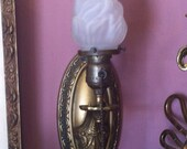 Early Twentieth Century Brass Electric Wall Sconce with Frosted Glass Torch Flame Light Shade