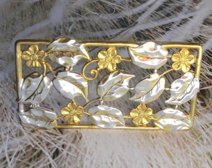 Repousse floral/flower scene pin in gold & silver tone ~vintage costume jewelry.