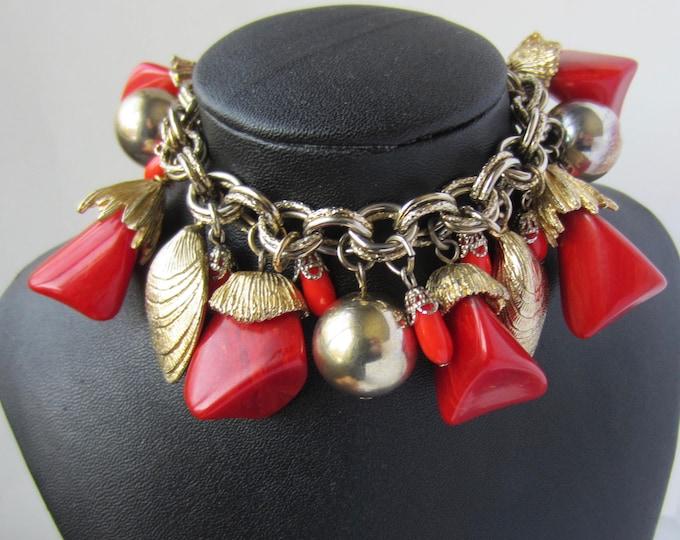 "Chunky BAKELiTE tested ""cha-cha"" charm Bracelet ~104 gm, midcentury costume jewelry"