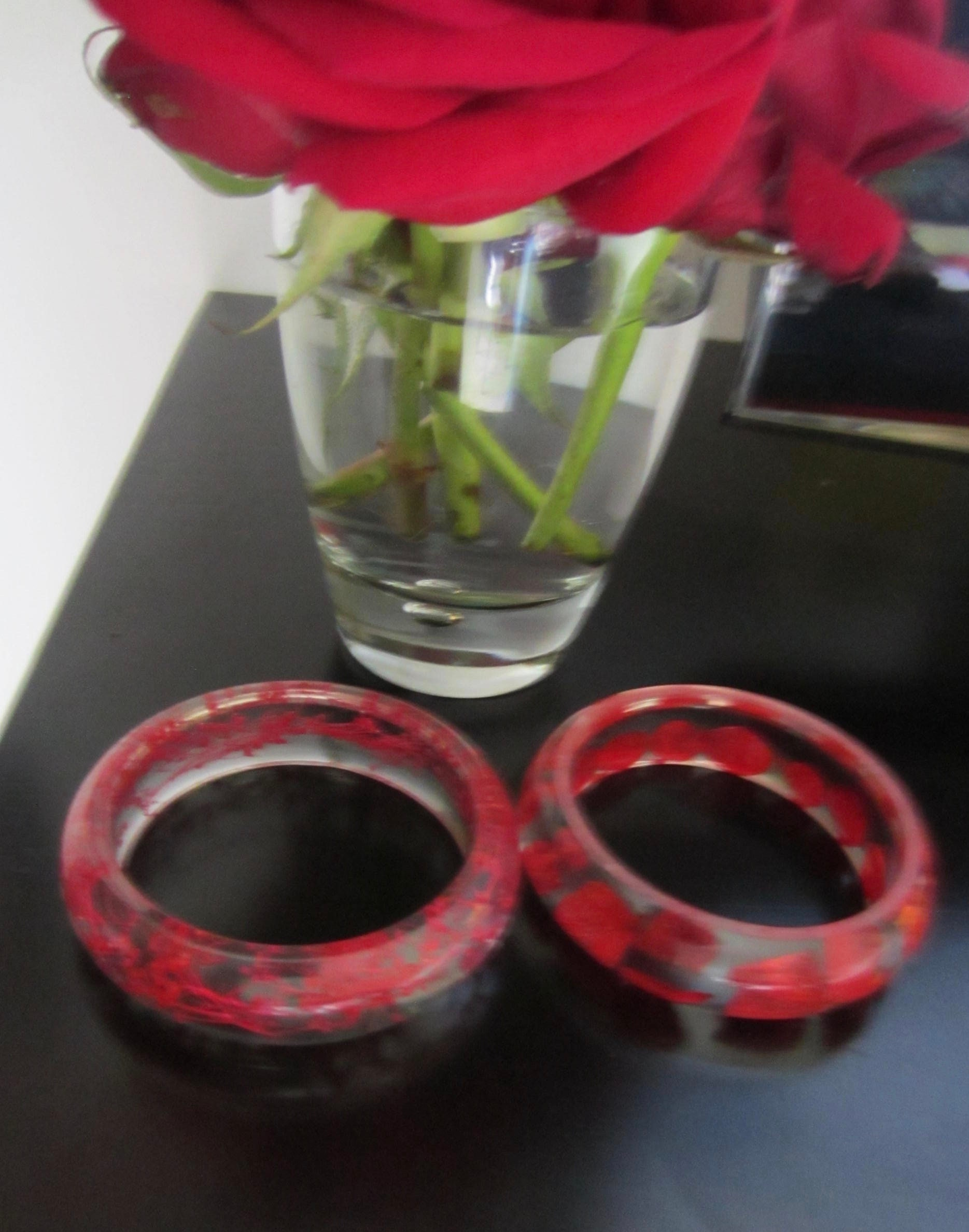 Pair Of Clear Lucite Bangles With Embedded Red Flowers Pretty