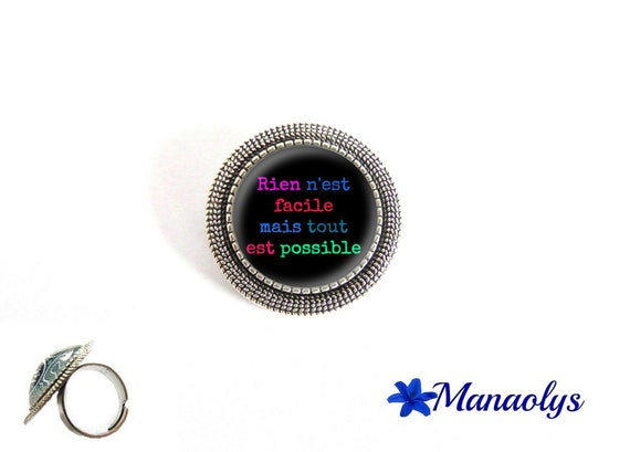 "Adjustable round ring silver pendent, quote, ""nothing is easy but anything is possible"" glass cabochons"
