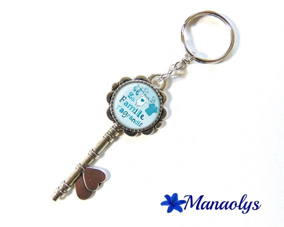 "Door keys or bag charm, birth announcement, ""the family"", 152 glass cabochons"