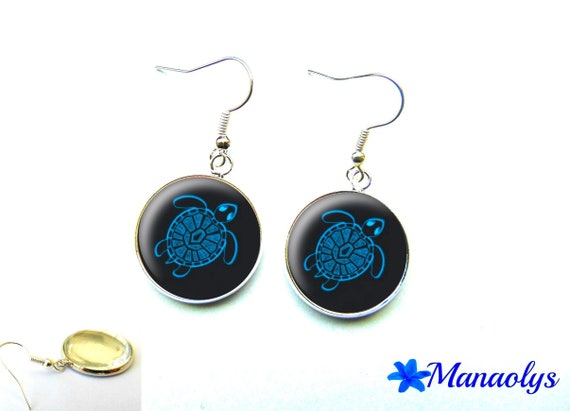 Blue turtle earrings on black background, 1587 glass cabochons