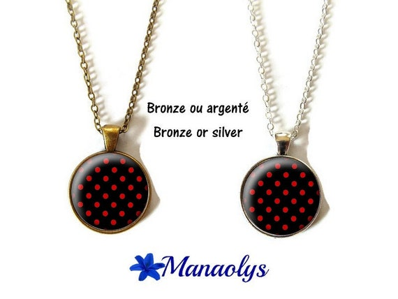 Necklace with red dots on black background, glass, silver or bronze supports cabochons