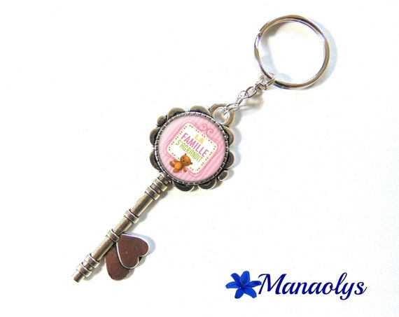 "Door keys or bag charm, birth announcement, ""the family"", 151 glass cabochons"