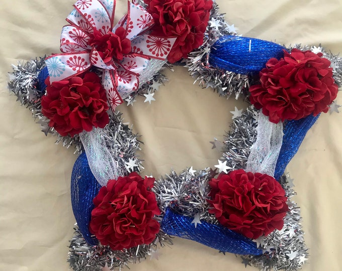 Red, White, and Blue Star ground grave decoration, cemetery flowers, grave flowers.