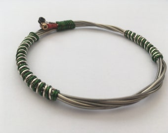 Recycled guitar string bracelet styled with flat wound strings and green and silver copper wire. Unisex Unique Guitarist Gift.