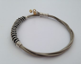 Recycled Guitar String Bracelet, styled with silver plated copper wire. Unisex Unique Guitarist Gift