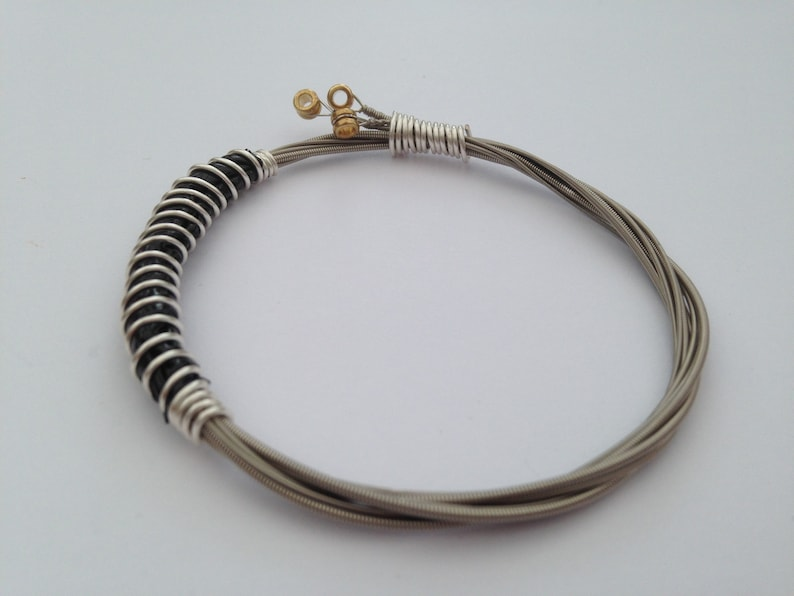 Recycled Guitar String Bracelet styled with silver plated Three Strings