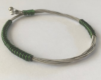 Recycled Guitar String Bracelet, styled with forest green and black copper wire. Unisex Unique Guitarist Gift