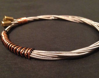 Limited Edition Recycled Fender bullet ends Guitar String Bracelet/Bangle: bound with black and bronze wire