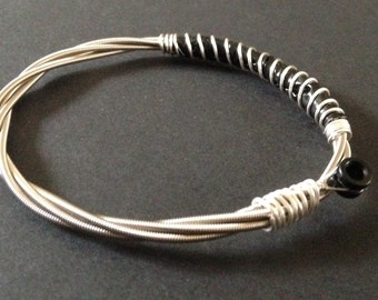 Recycled Bass Guitar String Bracelet, styled with silver plated copper wire. Unisex Unique Guitarist Gift