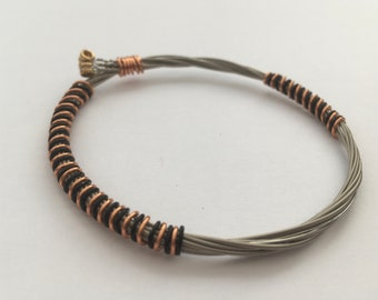 Recycled Guitar String Bracelet, styled with black and bronze copper wire. Unisex Unique Guitarist Gift