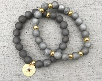 Grey druzy bracelets with gold charms, druzy charm bracelets, gold and druzy bracelets, gold and grey arm party, grey druzy charm bracelet