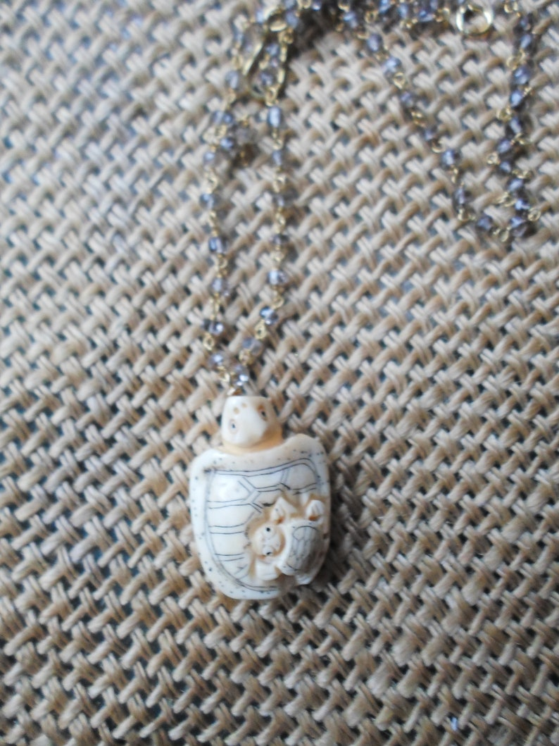Chinese carved ox bone Mom turtle with baby in amethyst gold plated chain