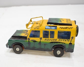 African Safari Recycled Red Tin Truck Pop Up Roof Tanzania Toy Safari Truck