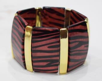 Bracelets Animal Print Gold  Sectional Stretch Lucite Bracelet