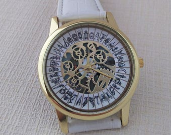 Alethiometer Inspired Wrist Watch with white strap
