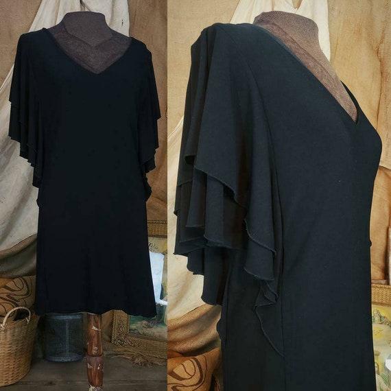 Badgley Mischka black dress with ruffled sleeves!
