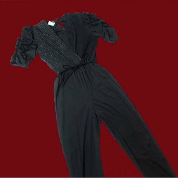 Vintage 1990s black jump suit with a wrap style to
