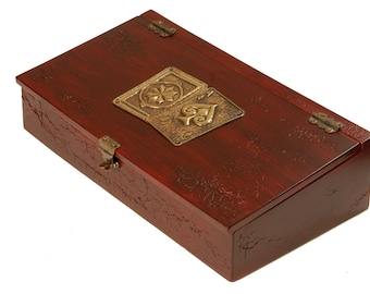 Wooden playing card box with bronze motif