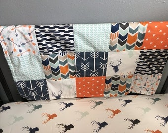chevron and Aztec fabrics navy and mint with a modern woodland theme including deer Custom made to order baby blanket in orange arrows