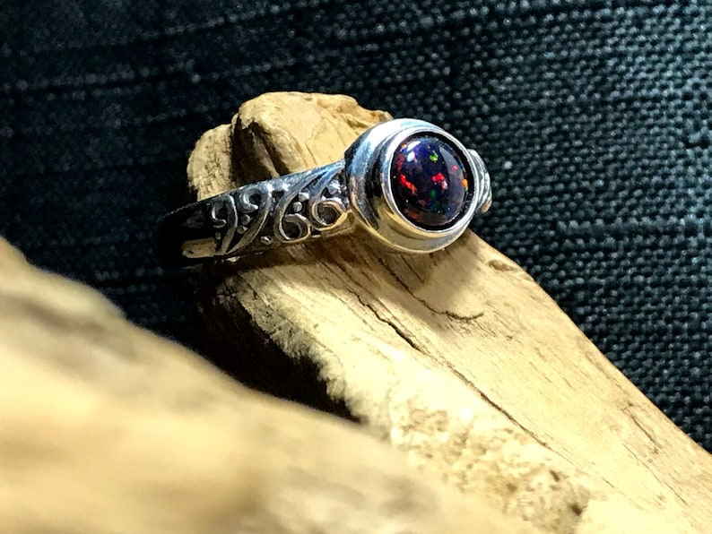 Sterling Silver celtic style adjustable ring with synthetic black opal