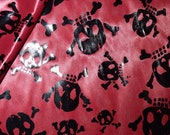 Black Skull And Cross Bone Foil on Red Shiny Light Weight Knit Halloween Costume Apparel by the yard fabric
