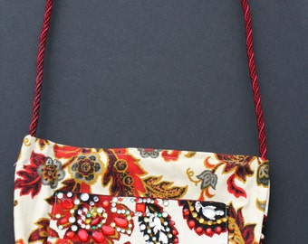 Beige cotton purse with floral and jeweled design. red beige bag with zipper, satin inside with pockets.