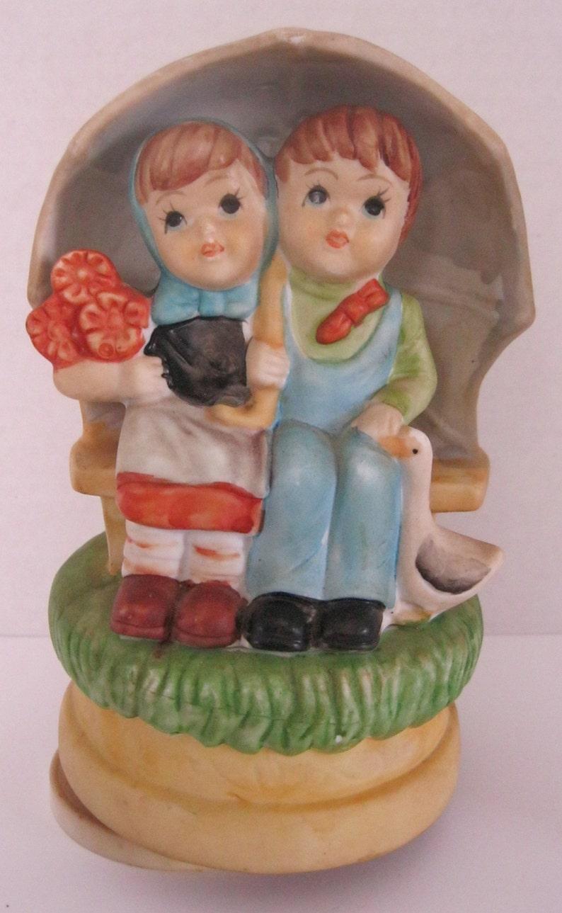 Vintage Children Figurine Music Box Rotating