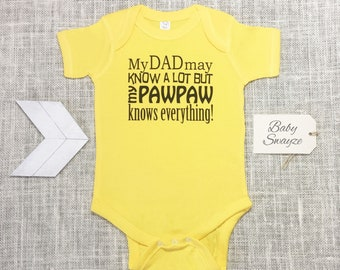 5d663ef10 My Dad May Know A Lot But My Pawpaw Knows Everything! Funny Baby One Piece  Bodysuit or Children's T-shirt - Color Options Available!