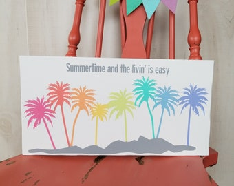 Summertime and the livin' is easy. Rainbow palm tree sign.
