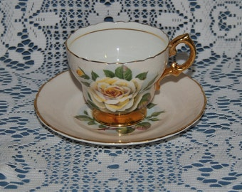 Beautiful Vintage Circa 1953, Regency, White With Yellow Roses, Fine Bone China Teacup And Saucer