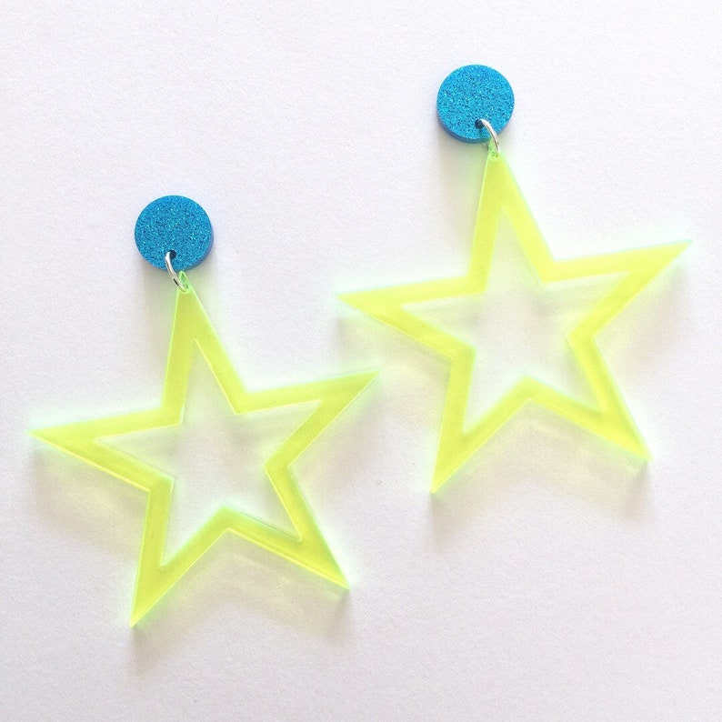 Pair Of Star Shaped Neon Ear Studs Yellow