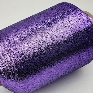 1 spool 500 g metallic yarn  Nm 83 pink 83.000 mkg on a cone