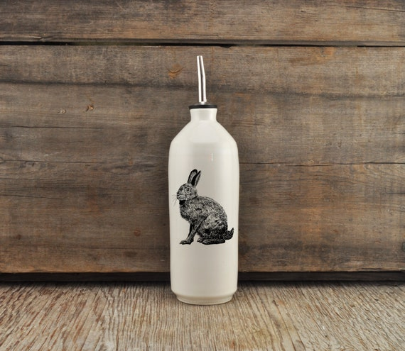 Handmade white glossy porcelain cruet with hare drawing by Cindy Labrecque, Canadian Wildlife collection