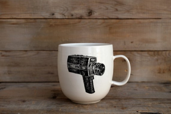 Porcelain coffee mug with Super 8 camera drawing by Cindy Labrecque