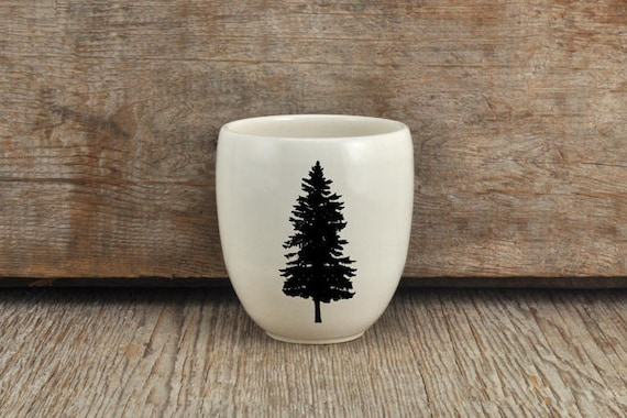 Porcelain coffee tumbler with pine tree photograph by Cindy Labrecque