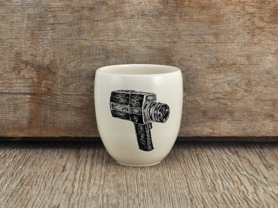 Porcelain coffee tumbler with Super 8 camera drawing by Cindy Labrecque