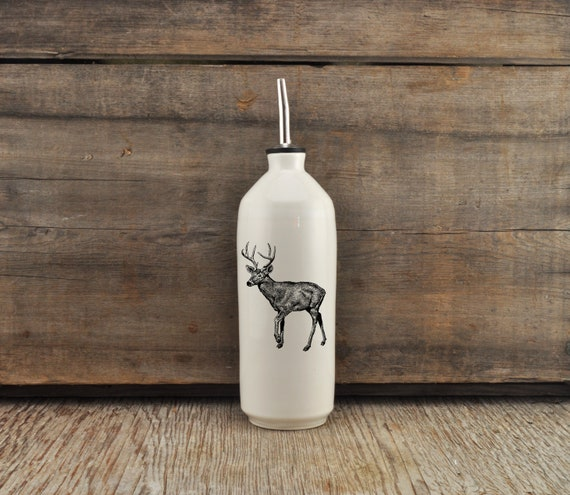 Handmade white glossy porcelain cruet with deer drawing by Cindy Labrecque, Canadian Wildlife collection