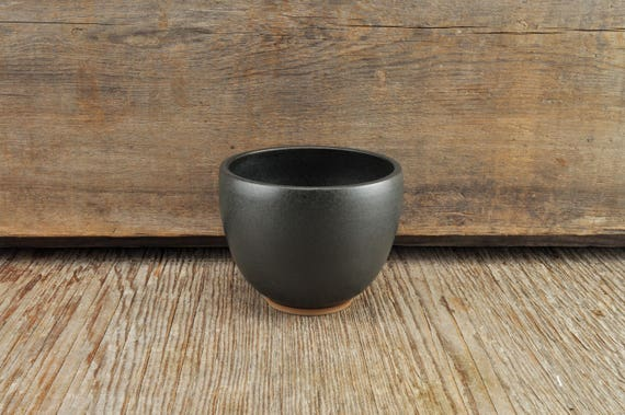 Black satine glaze stoneware coffee / tea cup