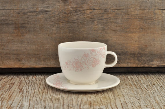 Porcelain coffee cup and saucer with vintage pink flower illustration