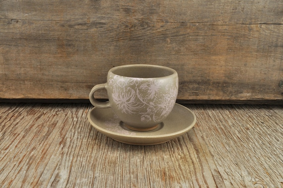Stoneware coffee cup and saucer with vintage pink flower illustration
