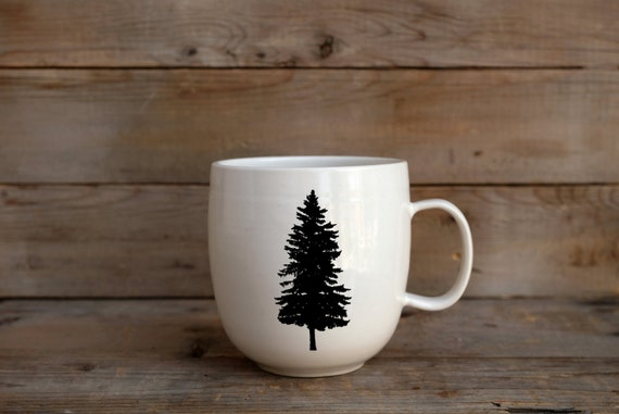 Porcelain coffee mug with pine tree photograph by Cindy Labrecque
