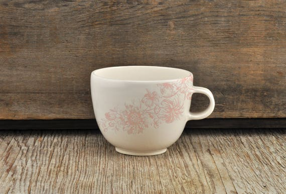 Porcelain coffee cup with vintage pink flower illustration